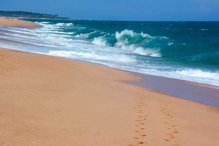 Two rows of the footprints on the sand paradise beach.