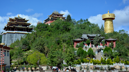 tibetian: Shangri-la central square, Guishan Si temple and biggest buddhist wheel in the world, Yunnan province, China. Editorial