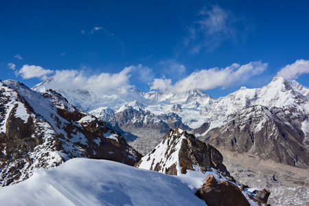 sherpa: Cho-Oyu Mount in clouds. View from the top of the Gokyo Ri. Himalayan mountains,  Nepal