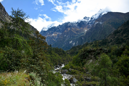 Beautiful of the valley, river and Himalayan Mountains on the way to Ghunsa. Trek to Kangchenjunga basecamp, Nepal Stock fotó - 118035427
