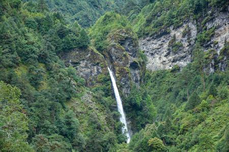 Beautiful view of the waterfall from Gyabla village. Trek to Kangchenjunga basecamp, Nepal Stock fotó