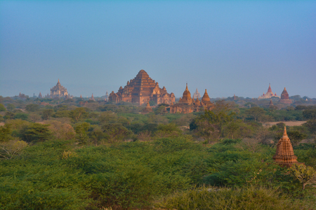 Beautiful Dhammayan Gyi Temple with Ananda and Thatbyinnyu Temples on the background. Bagan, Myanmar