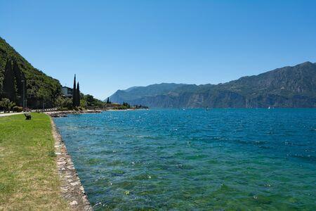 Lago Di Garda coastline, Italy. Promenade path along the lake. Stock fotó