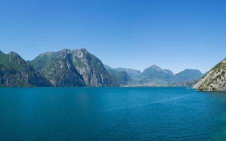 Beautiful panoramic view of Lago Di Garda coastline. Riva Del Garda and Nago-Torbole towns, Italy.
