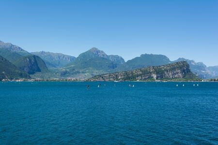 Beautiful view of Riva Del Garda and Nago-Torbole coastline and beaches with lots of windsurfers and boats, Italy. Archivio Fotografico