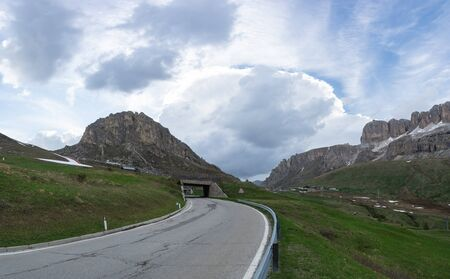 Road to the Pass Pordoi in Dolomites, Italy. Tunnels on the mountain road 写真素材