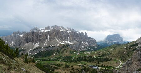 Panoramic view of the Sella group, Gardena Pass and Sassolungo mountain from Pizes de Cir. Dolomites, Italy 写真素材