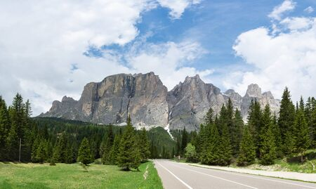 View on the alpine mountain road in Dolomites, Italy. Sella massif on the background