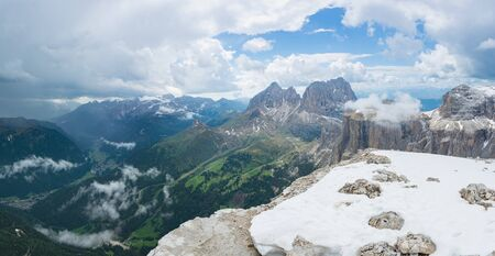 Beautiful panoramic view on the Piz Ciavazes and Sassolungo (Langkofel) mountains. Dolomites, Italy