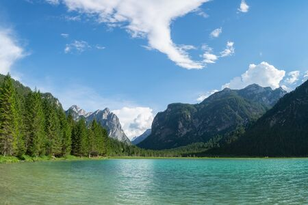 Beautiful panoramic view of Lago di Dobbiaco and Italian Alps. Cortina d'Ampezzo, South Tyrol