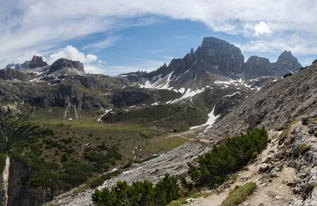 Tre Cime natural park. Trail to Rifugio Locatelli. Mount Paterno and Torre di Toblin on the background.