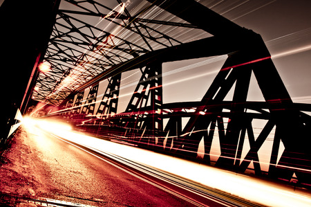 artificial lights: Traffic on the Bridge, Cremona, Italy