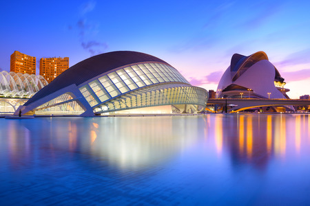 Valencia, Spain - July 31, 2016: The city of the Arts and Sciences and its reflection in the water at dusk. This complex of modern buildings was designed by architect Santiago Calatrava