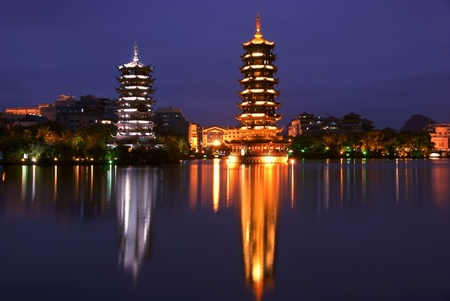 Double towers in guilin nightscape  photo