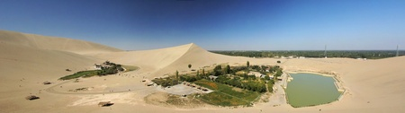 crescent lake: dunhuang of china,the crescent moon lake with singing sands mountain