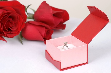 Diamond ring in box and red rose photo