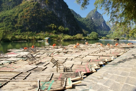 Bamboo raft with hill and river