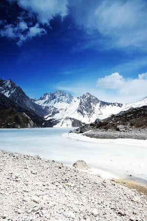 mountain with frozen lake photo