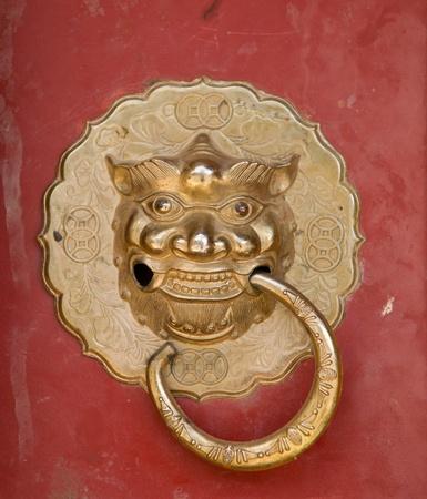 Doorknob of tibetan temple photo