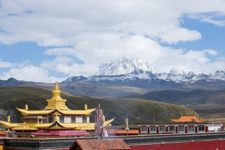 Golden temple with yala snow mountain Stock Photo