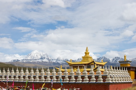 Golden temple with yala snow mountain photo