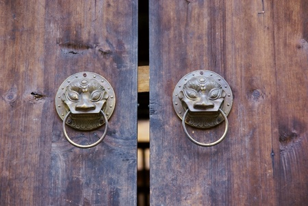Doorknob with wooden door photo