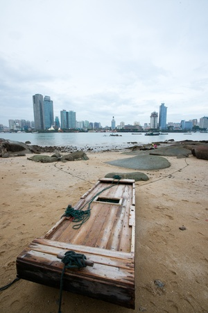boat with xiamen cityscape photo