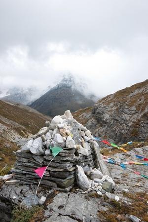 jokul: Marnyi stone stack with snow mountain in fog Stock Photo