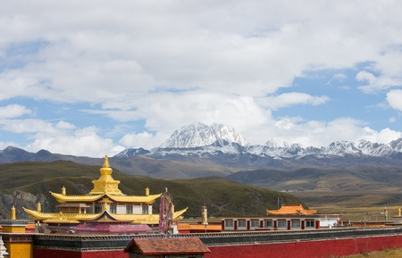 temple with snow mountain landscape photo