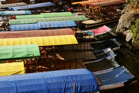 Bamboo raft with colorful roof