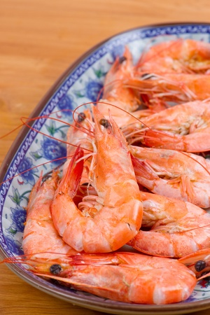 Cooked shrimp in plate photo