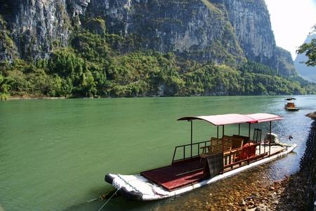 Bamboo raft with lijiang river photo