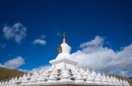 lamaism: Tibetan white Pagodas Stock Photo