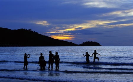 sunset with people in beach Stock Photo - 13258102