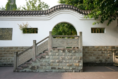 View of a moon gate with staircase in Chinese garden