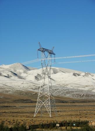 jokul: Telegraph pole with snow mountain