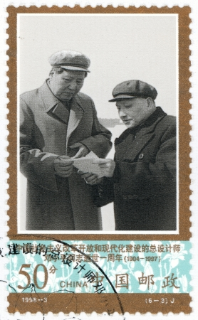 deng xiaoping: CHINA - CIRCA 1998  A stamp printed in China shows leader of the Communist Party of China Deng Xiaoping with Mao Zedong, circa 1998