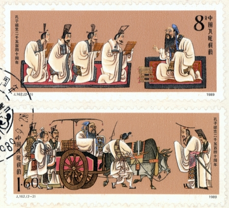 CHINA - CIRCA 1989  A stamp printed in China shows Confucius with his students,commemorate the 2540th anniversary of Confucius s birth, circa 1989 Stok Fotoğraf