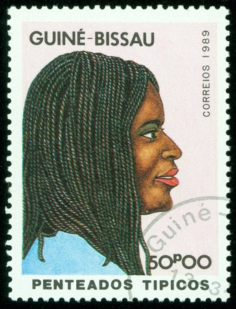GUINE - CIRCA 1989  A stamp printed in GUINE BISSAU shows Head of a native woman, circa 1989 photo