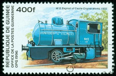 guinee: REPUBLIQUE DE GUINEE - CIRCA 1996   A stamp printed in Republique de Guinee shows a train, series, Train Queensland  Australie , circa 1996