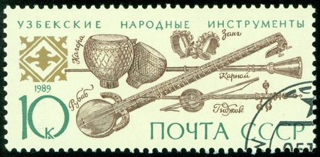 USSR - CIRCA 1989  A stamp printed in the USSR shows Uzbek folk music instruments, circa 1989 Stock Photo - 13795214