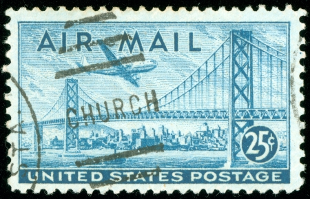 UNITED STATES OF AMERICA - CIRCA 1947  a stamp printed in the United States of America shows plane over San Francisco Oakland Bay Bridge, circa 1947
