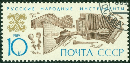 USSR - CIRCA 1989  A stamp printed in the USSR shows Russian folk music instruments, circa 1989 Stock Photo - 13795216