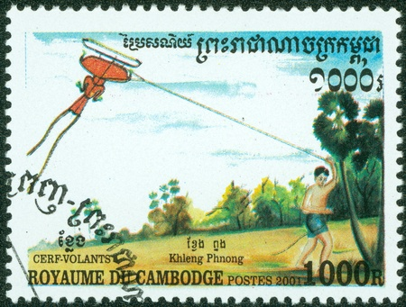 CAMBODIA - CIRCA 2001  stamp printed by Cambodia, shows a boy flying a kite, circa 2001