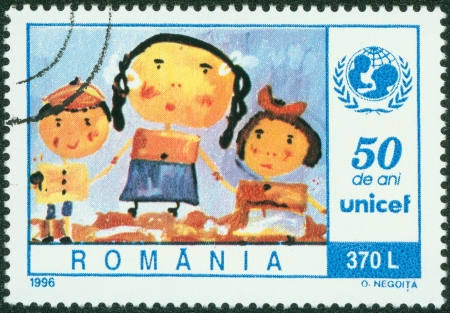 ROMANIA - CIRCA 1996  stamp printed by Romania, shows Children s painting, Mother and children, circa 1996 Stock Photo - 13824983