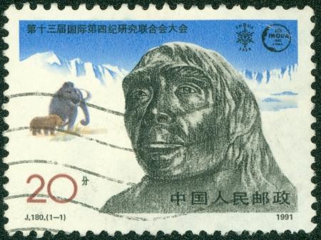 CHINA - CIRCA 1991  stamp printed by CHINA, shows Primitive man, circa 1991  photo
