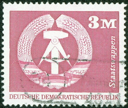 DDR- CIRCA 1975  A stamp printed in DDR shows Emblem of the DDR, circa 1975 Stock Photo - 13824978