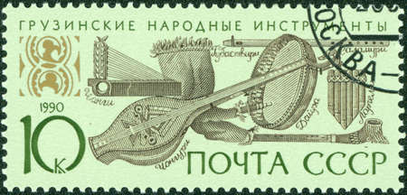 franked: USSR - CIRCA 1990  A stamp printed in the USSR shows Georgian folk music instruments, circa 1990  Stock Photo
