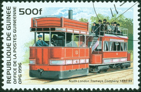 guinee: GUINEE- CIRCA 1996  A stamp printed in GUINEE shows a locomotive, circa 1996