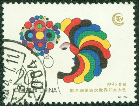 CHINA - CIRCA 1995  A stamp printed in CHINA shows Head of a woman, circa 1995 photo